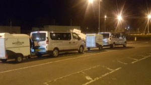 2 minivans with baggage trailers at Edinburgh Airport
